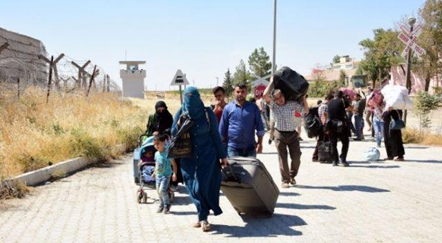 Ülkesine dönen göçmene para