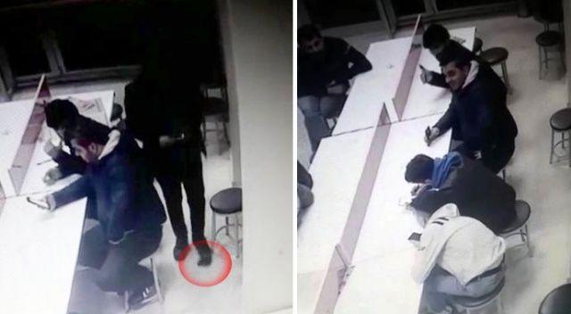 Yere düşen cüzdanı ayaklarıyla çalmaya çalıştılar, kameraya yakalandılar