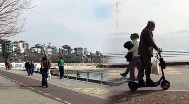 Yaşlı vatandaşın scooterla sahile çıkması pes dedirtti!
