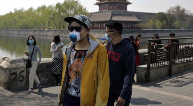 Çin'de korona kısıtlamaları hafifledi, turistik mekanlara ziyaretçi akını oldu