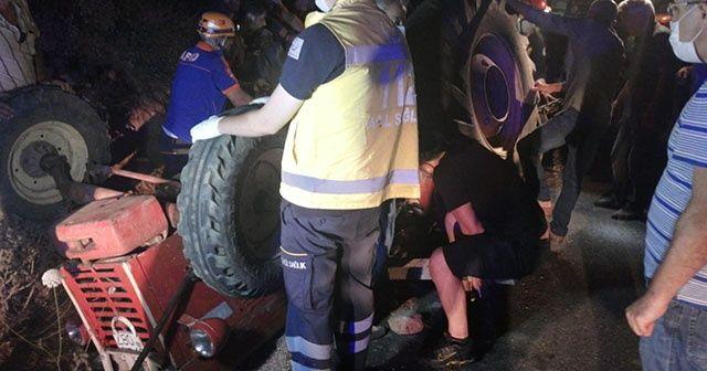 Devrilen traktörün altında kalan sürücü son anda kurtuldu