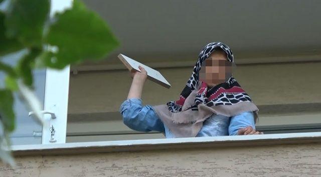 Evindeki eşyaları balkondan atan kadın gözaltına alındı