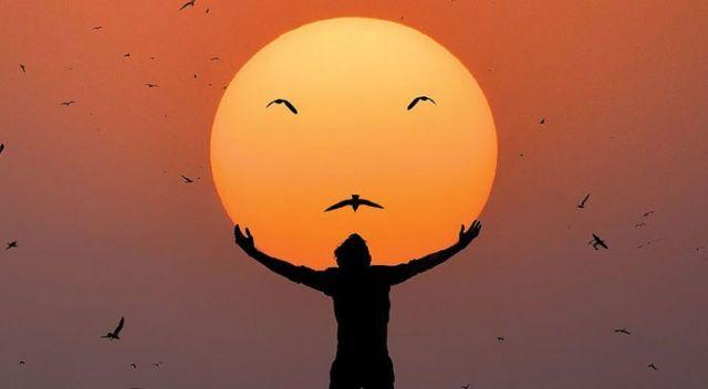 Gün batımı fotoğrafçısı güneşi oyuncak etti