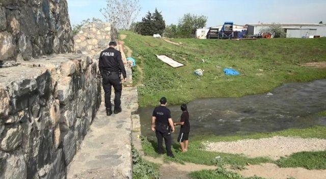 Bursa'da tam kapanmada kovalamaca: Derede yüzenler polisi görünce kaçtı