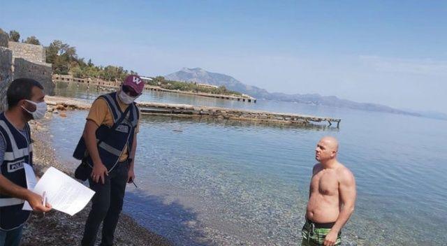 """Denize girdi, """"İşsizim, ceza kesmeyin"""" dedi"""