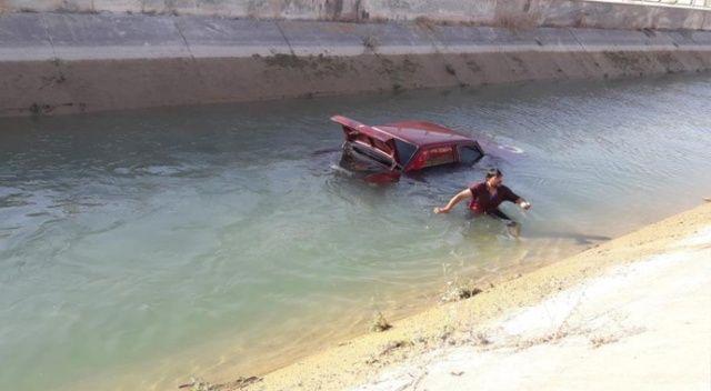 Kanala uçan otomobilden 2 kişi son anda kurtuldu