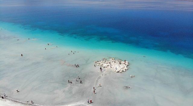 Salda Gölü'nde nargile içip ve çamur banyosu yapanlara ceza yağdı